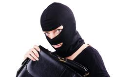 Industrial espionage concept with person in balaclava - stock photo
