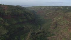 Open canyon mountains green stream Stock Footage