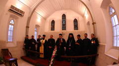 Christian leaders lit the Holy Fire in churches during Light Saturday procession Stock Footage