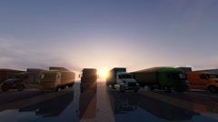 Row of trucks on a parking lot at a sunset - stock footage
