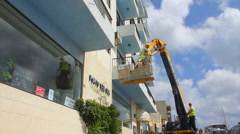 Elevated work platform, cherry picker, boom lift, man lift,  Stock Footage