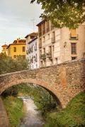 old bridge walking street river rio darro albaicin granada andalusia spain - stock photo