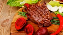 Steak garnished with green staff Stock Footage