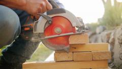 Construction worker cutting wood with circular electric saw. Slow motion. Stock Footage