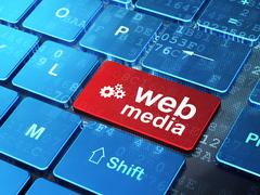 Web design concept: Gears and Web Media on computer keyboard Stock Illustration