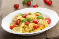 Stock Photo of tortellini with cheese and tomatoes