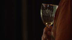 Wine tasting CU of taster and glass Stock Footage