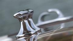 Chrome bollard on wooden boat - stock footage