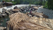 Stock Video Footage of coconut cottage in mountain river