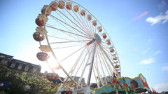 Ferris wheel with blue sky and sun Stock Footage