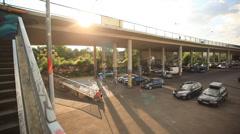 Urban Street sun and car bridge Stock Footage