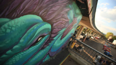 Graffiti Street Art with car bridge Stock Footage