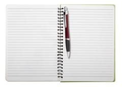 Used blank note book with ring binder and ball pen, isolated on white Stock Photos