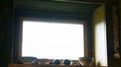 Kitchen knife hanging in cottage (tilt) Stock Footage
