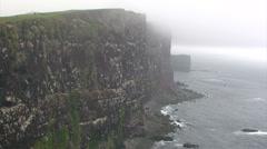 Black volcanic rock cliffs of Latrabjarg Stock Footage