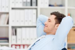 Contented businessman taking a break Stock Photos