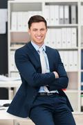 self-assured successful young businessman - stock photo
