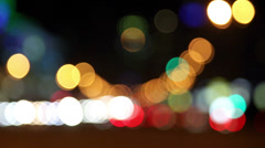 Transport goes on night street , transition of out-of-focus image to sharp Stock Footage