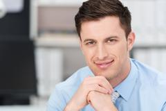 Smiling sincere young businessman Stock Photos