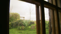 Normandy cottage window view - dolly Stock Footage