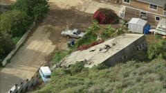 Landslide Homes Workers Destruction - stock footage