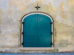 Teal French Doors Light up a Neutral Wall Stock Photos