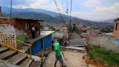 People walking in poor suburb in Medellin Stock Footage