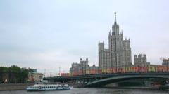 Tourist ship we melt by the high-rise building on Kotelnicheskaya Embankment Stock Footage