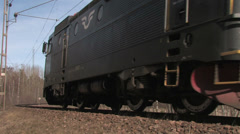 An electric locomotive pulled by an old steam train at a railway Stock Footage