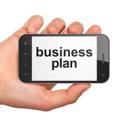 Hand holding smartphone with word business plan on display. Gene - stock illustration