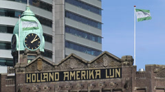 Jugendstil building Holland-America Line (Hotel New York) + zoom out + skyline Stock Footage