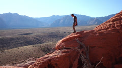 Man Hiking Red Rocks in Nevada Desert Stock Footage