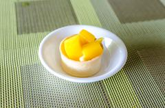 tropical mango tarte in little cup - stock photo
