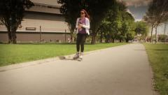 Girl on the Roller Blades in the Park Stock Footage