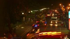 Vehicles moving up and down the street at night in a dense traffic Stock Footage