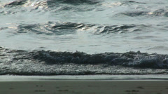 Sea waves rolling onto the beach Stock Footage