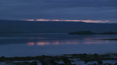 Cloudy fjord on the darkest hour of midnight sun Stock Footage