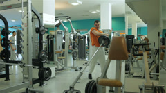 SS 001 young man doing exercise with barbell to develop chest muscles and biceps - stock footage
