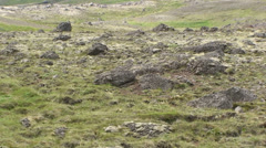 Moraines detail to wider shot of U shaped valley - Zoom out Stock Footage