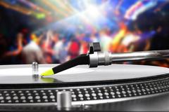 Dj turntable with vinyl record in the dance club Stock Photos