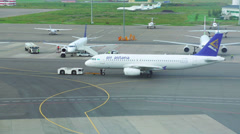 Airbus A320 jet airliner being prepared for a flight on the airfield Stock Footage