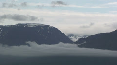 Low cloud hanging in the glacial valley Stock Footage