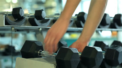 Sport SS 035 close-up of hands of a young man who takes a dumbbell - stock footage