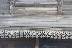 Traditional wooden Russian carved platband of an old wooden house in the prov - stock photo