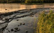Stock Photo of river rapids sunset