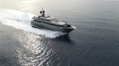 Aerial view of luxury yacht navigating Stock Footage
