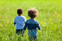 Cute african american little boys  playing outdoor - black people Stock Photos