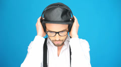 Man wearing headphones and hat Stock Footage