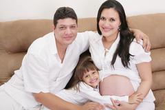 hispanic family expecting new baby - stock photo