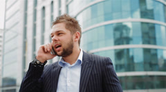 Business man in the city making a phone call with smartphone Stock Footage